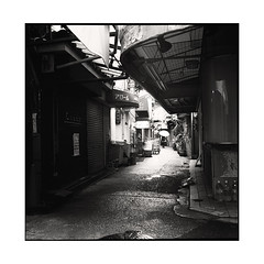 the umbrella  osaka, japan  2015 (lem's) Tags: umbrella gril femme parapluie alley alle march market darkness obscurit osaka japan japon rolleiflex planar