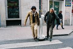 Three ages of man (subliner) Tags: green streetphotography calle nio kid father grandfather abuelo padre son hijo edades estatua paso de cebra cruzar bazar oriental bandera espaa spain