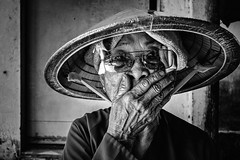 Shyness [EXPLORED] (-clicking-) Tags: streetphotography streetlife streetportrait old oldtime oldage oldmother oldwoman eld elderly elderlyportrait eldportrait shy shyness blackandwhite blackwhite nocolors nnl monochrome monotone bw vietnamesewomen vietnam emotion faces portrait