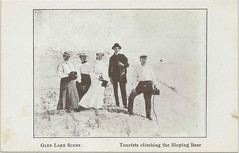 """NW Glen Haven Leelanau MI c.1906 Group of Tourists having climbe the Dunes to an outlook over Little and Big Glen Lake Card published c.1950 by MR Clements TYPO Sloping vs SLEEPING BEAR (UpNorth Memories - Donald (Don) Harrison) Tags: travel usa heritage history tourism st vintage antique michigan postcard memories restaurants hotels trailer roadside upnorth steamship cafes excursion attractions motels mackinac cottages cabins campgrounds city"""" bridge"""" island"""" """"car upnorthmemories rppc wonders"""" """"big """"railroad """"michigan memories"""" mac"""" """"state parks"""" entertainment"""" """"natural harrison"""" """"roadside ferry"""" """"travel """"don """"tourist """"mackinaw puremichigan stops"""" """"upnorth straits"""" ignace"""""""