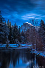 Yosemite National Park - Along The  Merced  - 1193 (www.karltonhuberphotography.com) Tags: california longexposure light sky snow nature water clouds forest reflections river landscape outdoors lowlight moody shadows peaceful wideangle calm yosemite halfdome yosemitenationalpark wilderness exploration monolith tranquil yosemitevalley mercedriver naturephotography 2015 landscapephotography diffusedlight smoothwater verticalimage wildplaces leefilters yosemiteicon leebigstopper karltonhuber nikond750