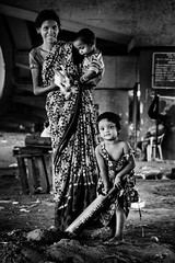 Endurance (jazzyoki) Tags: poverty life street family portrait people bw india rabbit bunny monochrome kids blackwhite poor documentary mumbai endurance bnw slums incredibleindia