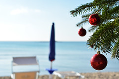 Natale a mare -  Christmas at sea. (sinetempore) Tags: sea water mare deckchair christmastree acqua salento puglia alberodinatale beachumbrella sdraio ombrellone portocesareo christmasatsea nataleamare