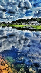 cameraphone blue houses homes sky green water clouds... (Photo: Mark.L.Sutherland on Flickr)
