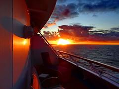 A glorious Pacific Ocean sunrise (peggyhr) Tags: ocean reflection sunrise pacificocean nclsun peggyhr heartawards level1photographyforrecreation thelooklevel1red thelooklevel2yellow thelooklevel3orange thelooklevel4purple thelooklevel5green thelooklevel6blue musictomyeyes~l1 morgenrotundabendrot super~sixbronzestage1 dsc06393a