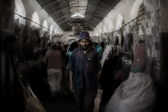 Schizophrenia (Chiara Battistini - Alter Native Photo) Tags: man market street editing looking straight hat angry conceptual walking travel photography indoor people person pack stone town zanzibar unguja blur tunnel portrait powerful tanzania africa african swahili photoshop downtown cool red blue psychology schizophrenia
