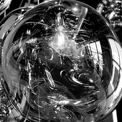 Reflections and Distortions (Seeing Visions) Tags: 2016 unitedstates us california ca losangeles la culvercity shop store glass reflection distortion lightfixture lightbulb windows person monochrome bw square raymondfujioka