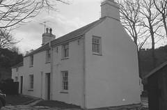A ghost disturbs Pete and Sian Allport after moving to Garreg Wen near Porthmadog, home of the harpist Dafydd y Garreg Wen (1556991)1 (LlGC ~ NLW) Tags: cymru wales llyfrgellgenedlaetholcymru nationallibraryofwales charlesgeoff19092002 negyddffilm filmnegatives hauntedhouse dafyddygarregwen ghost fright fear haunted
