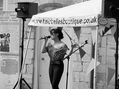 Chanteuse (pefkosmad) Tags: uk england blackandwhite bw woman girl vintage mono singing outdoor fair monotone gloucestershire retro gloucester singer microphone entertainer blackfriars performer priory artiste chanteuse