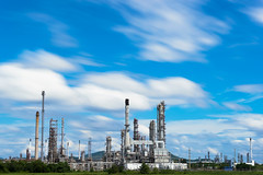Oil Refinery factory industry with blue sky and clouds. (MongkolChuewong) Tags: oil engineering engineer petroleum boiler fuel worker metal chemistry tower pollute pipe heavy tank liquid power pollution pipeline pollutant night refinery light steam chemical technology refine automobile energy chimney sphere gas gasoline industrial manufacturing production plant petrochemical smoke sky factory boil refinement industry capacity environment auto product storage landscape