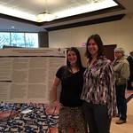 A student and a faculty member pose with the student's capstone poster.