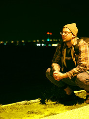 Self Identity (hpedrick) Tags: people selfportrait self portrait night nighttime river delaware memorial bridge new jersey water lights bokeh grass concrete flannel man male guy boy hats squatting bridges surreal thinking future past present outdoors