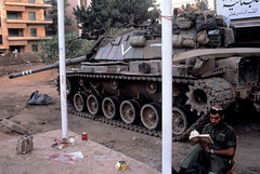 August 1982. It is time for prayer and meditation for an Israeli army position during the ceasefire in West Beirut. During the Lebanon War of 1982, Yasser Arafat and PLO forces were trapped in Beirut as Israeli Defense Forces encircled and bombed the city (k.aksoy93) Tags: army uniform militaryoccupation m60tank magachtank armã©edeterre charmilitaire extã©rieur exterior homme25ã45ans man25to45years soldat soldierarmy tankmilitaryvehicle uniforme guerrecivileauliban lebanesecivilwar occupationmilitaire israelinationality israã«liennationalitã© assis ironie irony kippa kippah lecteur prayer priã¨re reader seated idf magach6b lebanon
