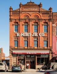 Eastern Market - R. Hirt. Jr. Co. (Z-Imagery) Tags: america architecture artandarchitecture building cultural detroit easternmarket editorial faade michigan motorcity northamerica photojournalism rhirtjrco richardsonian romanesque us usa unitedstates warehouse waynecounty aspect elevation entrance entryway exterior facade face frontage outdoor portal structure fujifilm finepix s9100 fujinon 107xopticalzoom 62667mmf2849