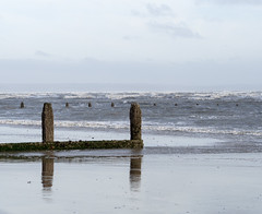 Low tide (Mary Gerard) Tags: groynes reflections wind sea beach kent