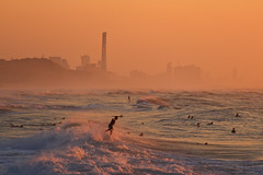 Surfers in the rough sea - Tel-Aviv beach (Lior. L) Tags: surfersintheroughseatelavivbeach surfersintheroughsea telaviv beach surfers roughsea telavivbeach seascapes sea sunset action actionphotography buildings skyline landscape israel sport extreamsport extream surf surfing waves water travel travelinisrael