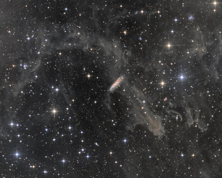 NGC7497 - a spiral galaxy through the dust