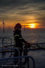 Fire Guard in Sunset :-) (Askjell's Photo) Tags: belgium blighbank fireman maritime northsea offshore sea ships vessel windturbine windmill windpower askjell