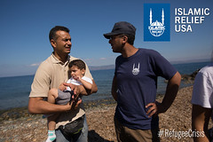 Islamic Relief staff speak to refugees at the beach