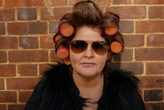 Woman with curlers L1260969 (rafhuggins) Tags: street leica portrait woman brick london hair hackney curlers