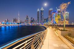 Dubai Water Canal (Mark A. Pedregosa) Tags: urbanscape cityscapephotography burjkhalifa bluehour nightphotography moon longexposure dubai unitedarabemirates canon canon1018 dubaiwatercanal canal markpedregosaphotography markpedregosa