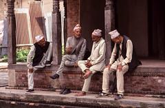 Spin a yarn (robertdownie) Tags: sitting wood brick laugh stone kathmandu men conversation talking laughing yarn nepal pashupatinath hindu bagmati