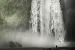 Powerful nature (Chris Herzog) Tags: natural energy nature flowing tiny huge waterfall cascade outdoors skogar person landmark famous stream force powerful curtain flow beautiful big water landscape spray giant iceland skogafoss river island drop scale