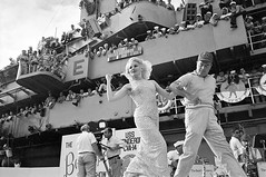 #Actress Carroll Baker snaps her fingers at sailors cheering from the bridge of aircraft carrier USS Ticonderoga as Bob Hope leads her across a stage set up on the flight deck. More than 2,500 sailors saw the Hope troupe's show on the carrier off the coas (Histolines) Tags: histolines history timeline retro vinatage actress carroll baker snaps her fingers sailors cheering from bridge aircraft carrier uss ticonderoga bob hope leads across stage set up flight deck more than 2 500 saw troupes show off coast vietnam december 27 1965 1920x1276 vintage dh historyporn httpifttt2gvdkfm