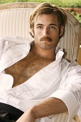216 (rrttrrtt555) Tags: hair hairy chest muscles mustache stubble shadow shirt lounge arms pants formal chair outdoors blond eyes stare chin patio sideburns leaning tuxedo