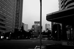 (lemonhats) Tags: olympusmjupanorama olympus3535 fujifilmneopanacros100 classiccamera vintagecamera automatic pointandshoot 3535 autofocus primelens wideprime iso100 35mmprintfilm blackandwhite traditionalphotography analoguephotography filmphotography filmisalive shootfilm fpper kodakd76 homedevelopment walking aoyamaitchome shibuyaku tokyoto japan urban street dusk roppongihillstower