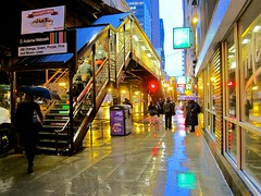 This Floating World (rwchicago) Tags: chicago winter rain evening rushhour downtown urban loop street streets chicagoist umbrella cta masstransit publictransit station el eltrain elevatedtrain