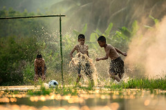 Soccer action (Sutipond Somnam) Tags: people activity asia backgrounds boy champion championship child children competitive country countryside creek culture field foot football friends fun game goal grand grass jump laos lifestyle light little malaysia myanamr nature panorama play player playing soccer soccerball sport stadium strong success sunlight sunny team together traditional training travel watersplash winner