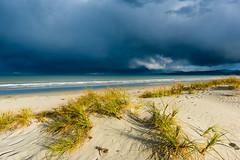 Crazy weather (Stefan Nikoloff) Tags: nikon d810 24mm seascape waves clouds storm grass sand blue dark amazing light detail mountains rainbow