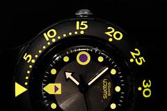 Macro Mondays - Arrow (tinfrey) Tags: 2016 canonef100mmf28macrousm canoneos6d december arrow black macro macromondays scuba200 swatch swissmade watch yellow shamublackwave