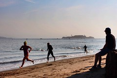 Escape from Alcatraz (Wyldur) Tags: ocean sanfrancisco california travel sea motion beach sports race swimming dawn sand shadows action documentary explore alcatraz norcal athletes thebay storytelling triathlete alcatrazisland documentaryphotography