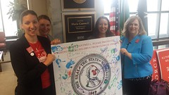 Delivering a climate postcard to Senator Maria Cantwell.
