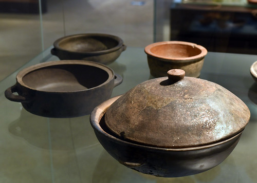 Roman ceramic bowls, pans, and lid from Braga