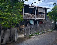 Glimpse of life (Antoine - Bkk) Tags: amarapura mandalay darktable architecture vernacular xm1 snapshot street life house wood