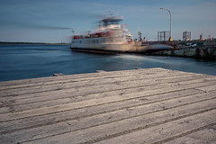 the departure lounge (Port View) Tags: fujixe2 westport brierisland grandpassage novascotia canada cans2s 2016 summer ferry wharf dock lighthouse motion movement leaving departure joecasey