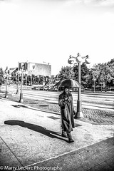 Lotion free ... (Marty 1955 ...) Tags: blackwhite candid canada ottawa street man martyleclercphotography umbrellalights shadows streetperson coat umbrella gloves boots glasses sunglasses eccentric elginstreet