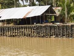 IMG_3335 (program monkey) Tags: vietnam mekong river delta cargo boat ben tre tra vinh palm tree coconut processing wall weave