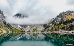 see you soon but from above (ashtenphoto) Tags: lake colchuck enchantment zone mountains pnw pacific northwest hike outdoors water blue clouds sky peak yellow trees green fog backcountry mountaineering fall autumn