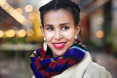 Hiwot [Stranger #15/100][Explored 18-Nov-2016] (Vijay Britto Photography) Tags: blue beautifullady 100strangers nikon d750 18mm smile red bokeh naturallight outdoorportraits reflector scarf ethiopian earrings
