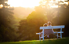 Sisters (Wojtek Piatek) Tags: park ireland sunset portrait dublin sun love grass sunshine kids sisters bench golden haze child affection outdoor sony joy blanket laugh hours phoenixpark childrenphotography a99 zeiss135