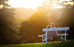 Sisters (Wojtek Piatek) Tags: park ireland sunset portrait dublin sun love grass sunshine kids sisters bench golden haze child affection outdoor sony joy blanket laugh hours phoenixpark childrenphotography a99 zeiss135