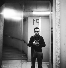 Rolleiselfie Famagosta parking (magistergalempicus) Tags: street reflection 6x6 self square photography mirror blackwhite milano elevator e protrait autoritratto bianco metropolitana nero biancoenero autoscatto blackdiamond specchio ascensore selfie riflesso famagosta rolleiflext blackwhitephotos bwartaward analogicait rolleirpx100 famagostam2