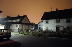 at midnight in the village (BZK2011) Tags: auto street car night dorf village darkness nightshot nacht midnight nachtaufnahme highiso opelastra dunkelheit roterhimmel mitternacht strase hoheempfindlichkeit sonycybershotrx100 roternachthimmel