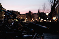 Bikes (FCarboni) Tags: street sunset people sun holland amsterdam 35mm lights colours fuji sundown 14 nederland cities bikes fujifilm fujinon approvato
