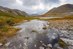 Beinn Eighe lochan (macdonald.archie) Tags: beinneighe highlands quartzite scotland torridon clouds grass landscape loch lochan moorland mountainloch mountains rocks sky windy