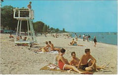 """SE Port Huron MI 1950s Female Lucky Lifeguard Checking Out the Hunky Fellas with LOTS OF BEACH BABES and Family FUN to be had at the Lake Huron Beach most likely Gratiot Beach (UpNorth Memories - Donald (Don) Harrison) Tags: vintage antique postcard rppc """"don harrison"""" """"upnorth memories"""" upnorth memories upnorthmemories michigan history heritage travel tourism """"michigan roadside restaurants cafes motels hotels """"tourist stops"""" """"travel trailer parks"""" campgrounds cottages cabins """"roadside entertainment"""" """"natural wonders"""" attractions usa puremichigan"""